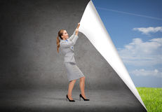 Smiling businesswoman changing sceneries stock images