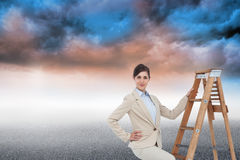 Smiling businesswoman climbing the career ladder Stock Photography