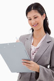 Smiling businesswoman with clipboard Stock Photo