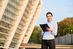 Smiling businesswoman with clipboard. Royalty Free Stock Image