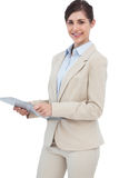 Smiling businesswoman with clipboard Royalty Free Stock Images