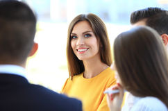 Smiling businesswoman with colleagues stock photos