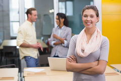 Smiling businesswoman with colleagues in office Stock Images