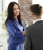 Smiling businesswoman communicating with male colleague. Business couple talking in office Stock Images