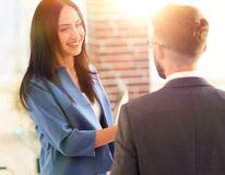 Smiling businesswoman communicating with male colleague. Business couple talking in office Royalty Free Stock Image