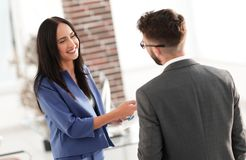 Smiling businesswoman communicating with male colleague. Business couple talking in office Stock Image