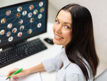 Smiling businesswoman with computer Stock Photos