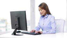 Smiling businesswoman with computer in office stock footage