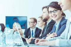 Smiling businesswoman at conference royalty free stock image