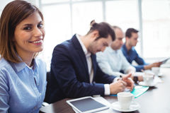 Smiling businesswoman with coworkers in meeting room Royalty Free Stock Photo