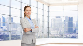 Smiling businesswoman with crossed arms Stock Photos
