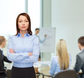 Smiling businesswoman with crossed arms at office Stock Photography