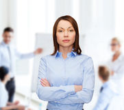 Smiling businesswoman with crossed arms at office Stock Image