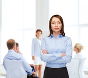 Smiling businesswoman with crossed arms at office Royalty Free Stock Photo