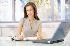 Smiling businesswoman at desk Royalty Free Stock Image
