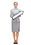 Smiling businesswoman with direction arrow sign Stock Image
