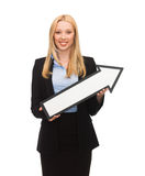 Smiling businesswoman with direction arrow sign Royalty Free Stock Image