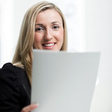 Smiling businesswoman with a document in her hand Royalty Free Stock Images