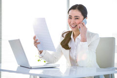 Smiling businesswoman with document phoning Royalty Free Stock Photo
