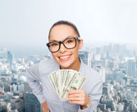 Smiling businesswoman with dollar cash money Royalty Free Stock Photos