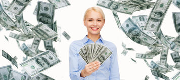 Smiling businesswoman with dollar cash money. Business, money, finance, people and banking concept - smiling businesswoman with dollar cash money Royalty Free Stock Images