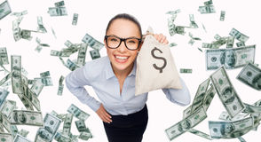Smiling businesswoman with dollar cash money. Business, money, finance, people and banking concept - smiling businesswoman with bag of dollar cash money Royalty Free Stock Images