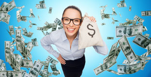Smiling businesswoman with dollar cash money. Business, money, finance, people and banking concept - smiling businesswoman with bag of dollar cash money over Royalty Free Stock Image
