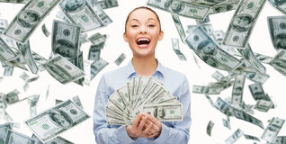 Smiling businesswoman with dollar cash money. Business, money, finance, people and banking concept - smiling businesswoman with heap of dollar cash money Stock Photography