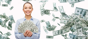Smiling businesswoman with dollar cash money. Business, money, finance, people and banking concept - smiling businesswoman with heap of dollar cash money Royalty Free Stock Images