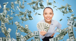 Smiling businesswoman with dollar cash money. Business, money, finance, people and banking concept - smiling businesswoman with heap of dollar cash money over Stock Photography