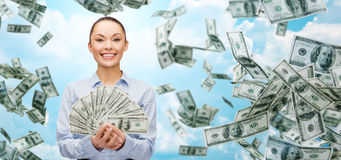Smiling businesswoman with dollar cash money Stock Photography