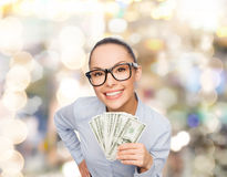 Smiling businesswoman with dollar cash money Stock Images