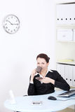 Smiling businesswoman drinking coffee. Royalty Free Stock Photo