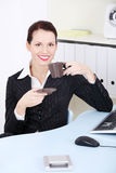 Smiling businesswoman drinking coffee. Royalty Free Stock Images