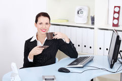 Smiling businesswoman drinking coffee. Stock Image