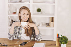 Smiling businesswoman drinking coffee royalty free stock photography