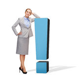 Smiling businesswoman with exclamation mark Stock Photography