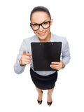 Smiling businesswoman in eyeglasses with clipboard Royalty Free Stock Image