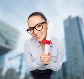 Smiling businesswoman in eyeglasses with diploma Stock Image