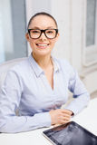 Smiling businesswoman in eyeglasses with tablet pc Royalty Free Stock Photography