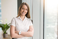 Smiling businesswoman feeling optimistic at office Royalty Free Stock Photo