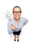 Smiling businesswoman with finger up Stock Photos