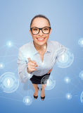 Smiling businesswoman with finger up Stock Image