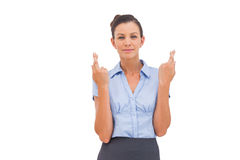 Smiling businesswoman with fingers crossed Royalty Free Stock Image