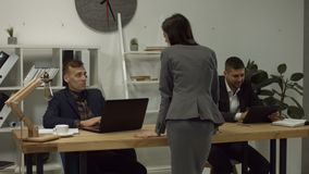 Smiling businesswoman flirting with man in office stock video footage