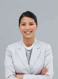 Smiling businesswoman with folded arms Royalty Free Stock Image