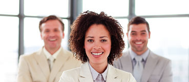 Smiling businesswoman with folded arms in office Royalty Free Stock Image