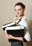 smiling businesswoman with folders in hands Royalty Free Stock Photo