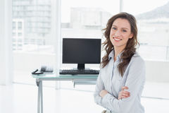 Smiling businesswoman in front of computer at office Royalty Free Stock Photo