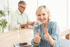Smiling businesswoman gesturing thumbs up Royalty Free Stock Images